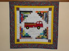 Appliqued Fire Truck Baby Quilt,  Patchwork background highlights the Red Fire Engine.. $86.00, via Etsy.