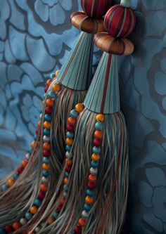 Turqoise Carnival Temari Tieback. Beautifully crafted, vibrant fringe in double satin ribbon with silk covered spheres and crystal beaded strands, fine silk covered bobbles