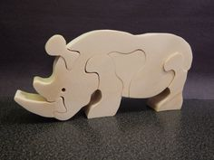 This stand alone rhino puzzle is made of pine wood and it is left natural without any finish. It helps with fine motor skills development and critical thinking. Dimensions: 6 long 3 tall 0.75 wide Please note that the puzzle contains small pieces.   Thanks for looking at my shop. Please stop back often to see whats new