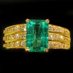 Estate diamond top notch emerald engagement ring by Kutchinsky