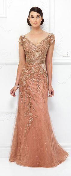 This ultra-flattering fit and flare gown crafted from embroidered illusion, lace with metallic embroidery, heat set stones and hand-beading features illusion lace cap sleeves, front and back wide V-necklines, a linear beaded bodice creating a crisscross design on the front, a beaded faux belt around the natural waist, splattered-like embroidery on the skirt that asymmetrically …
