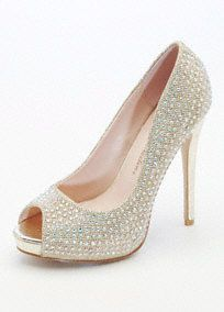 """Add glamour and drama to any outfit in these sensational glitter platform heels! Glitter mesh platform heels feature sparkling crystal detail. Heel measures 4"""". Platform measures 1/2"""". Fully lined. Imported."""