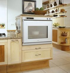 The oven is lower than a standard wall oven and opens from the side like a refrigerator. An oversized cutting board under the door pulls out to give added prep space or room to rest heavy dishes.