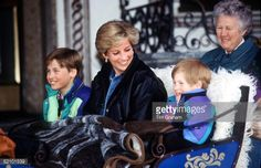 MARCH 30: Princess Diana With Prince William And Prince Henry (harry) In Lech, Austria. They Are Sitting In A Carriage With A Blanket Covering Them. Sitting Behind Is Their Nanny Olga Powell