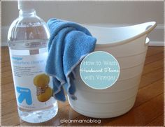 "Wash Hardwood Floors with Vinegar + Hot Water: ""My floors have never looked cleaner and they stay cleaner for longer."" I used a microfiber cloth, wrung almost dry, and a bucket with warm water + white vinegar.  The correct ratio of water to white vinegar is 1/2 cup white vinegar to 1 gallon of warm/hot water."