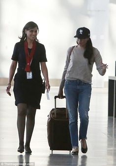 Meghan is preparing to board a seven hour flight back to the UK