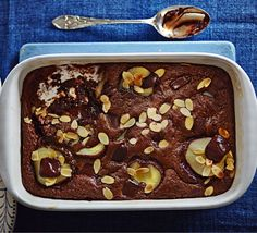 This hot, gooey chocolate pud, with dark chocolate and canned pears, can be made ahead and frozen - a perfect no-fuss dinner party dessert