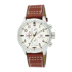 Tommy Hilfiger Men's 1790684 Sport Multi Eye Stainless Steel Watch Tommy Hilfiger. $120.00. Water resistant to 165 feet (50 M). Sport multi eye and three hand date function. Stainless steel case, off white round dial, Arabic numeral with dial markers. Brown leather strap with contrast stitching with buckle. Case diameter: 45.50 mm. Save 11%!