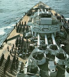 A beautiful color photo of the crew of the HMS Nelson stands for inspection at the port at Algiers, Algeria, 1943.