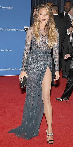 White House Correspondents' Dinner: The Nerd Prom's Most Gorgeous Gowns   CHRISSY TEIGEN   wearing a super-high slit Zuhair Murad gown with a sheer bodice, heavily jeweled heels, Effy jewels and deep wine lips.