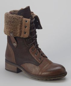 Step out in style in these rustic canvas- and faux leather-paneled lace-up boots. The fold-over feature and buckle snap finish make this pair a versatile favorite.1.5'' heel10'' unfolded shaft7.5'' folded shaft13'' circumferenceLace-up / zipper clos...