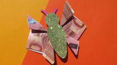Schmetterling, der aus zwei Geldscheinen gefaltet wurde als Geldgeschenk
