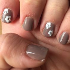 Brown beige nails with white flowers and strass