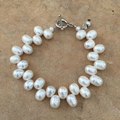 Pearl Bracelet. White Dancing Pearls with  sterling silver and a dangle Charm, woman's beadwork bracelet. 7 1/2inch