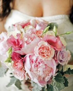 Peonies, roses, and lisianthus in pale shades of pink make up this bride's flirty clutch.