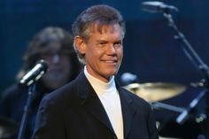 More than two years after the medical crisis that almost took his life, Randy Travis made his return to the Grand Ole Opry on Friday night (Sept. 25).