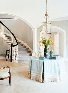 Classic, skirted table with a scene that changes seasonally. Samuel and Sons Passementerie Entry Stairs, Entry Hallway, Grand Staircase, Staircase Design, Design Entrée, House Design, Love Home, My Dream Home, South Shore Decorating