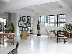 Painted concrete floors in Vincent Wolfe's loft. Artwork, furniture & accessories really pop. Painted Cement Floors, Stenciled Concrete Floor, White Painted Floors, Painting Concrete, White Concrete, Epoxy Floor, Stained Concrete, Polished Concrete, White Flooring