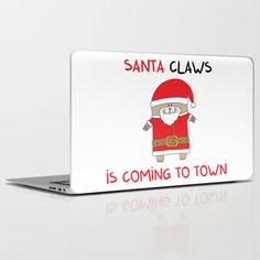 SANTA CLAWS is coming to town Laptop & iPad Skin