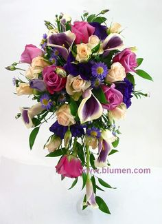 www.blumen.com  BW-107 Cascade bouquet of purple lisianthus, lavender roses, purple spray asters, white spray roses and Picasso mini calla lilies.