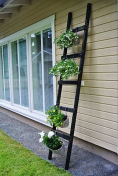 DIY - i have plenty of ladders, perhaps this can be an idea?