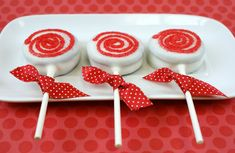 Oreos dipped in white chocolate (put on sticks) with red frosting to look like peppermints