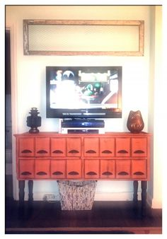Refurbished seed cabinet made entertainment center. The drawers are perfect cd's and misc.