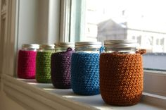 I love drinking out of mason jars like an old moonshiner, and these knitted coozies make it even cooler. $33.00 #knit #coozie #jars #drinkware #kitchen #party