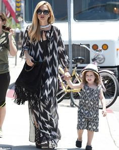 Seeing double: Fashion stylist Rachel Zoe wore an on-trend black and white frock and dress...