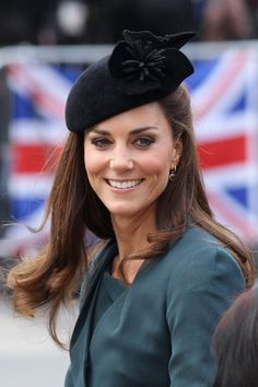 Catherine, Duchess of Cambridge smiles as she arrives in Leicester city centre on March 8, 2012 in Leicester, England. The royal visit to Leicester marks the first date of Queen Elizabeth II's Diamond Jubilee tour of the UK between March 8 and July 25, 2012.