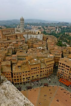 Siena, Italy. Been here! The town's center is in the shape of a shell! So cool to experience in person!