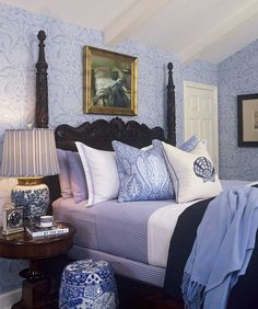 This bedroom by Barclay Butera  Design has an old-world feel. I love the wallpaper. the four poster bed and her use of many shades of blue and stripes and prints...V