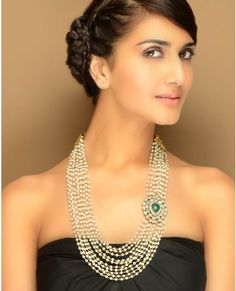 multi-strand necklace of faux pearls with a green stone side pendant from TAD