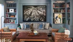 """""""To help make the space appear bigger, we painted it all one color. I chose a soothing, iridescent blue. It is a high-gloss paint that adds a sheen to the walls, so it reflects light and really opens up the room. Another trick: using the photograph of an old Parisian train station with angles, which draws the eye in and adds dimension."""""""