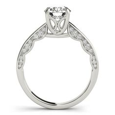 Diamond Surprise Engagement Ring Moissanite Center Stone by Moissanite Rings. Shop now at https://www.moissaniterings.com!