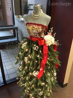 Our talented receptionist created this fashionable 'tree' for the Country Sampler offices. Mannequin Christmas Tree, Dress Form Christmas Tree, Christmas Door, Holiday Tree, Christmas Wishes, Xmas Tree, Christmas Tree Decorations, Christmas Time, Christmas Crafts