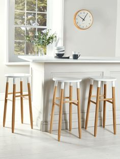 You asked for our best selling Weathered Oak Stool in a lower version- and now we've delivered! New and improved with smoother legs, our robust low farmhouse stool is beautifully crafted from weathered oak with a carved seat for comfort. Oak Bar Stools, White Dining Room Chairs, White Stool, Patio Chair Cushions, Spring Home Decor, Oak Stool, White Wood Bar Stools, Kitchen Chairs, Home Decor