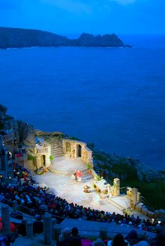 The Minack Theatre - built into the cliff like a Roman amphitheatre and set under the stars with the beautiful backdrop of the ocean. Porthcurno, Cornwall, England.