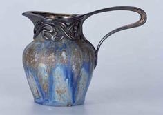Alexandre Bigot ceramic pitcher, silver mounting designed by Edward Colonna, 1899.