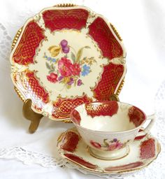 A lovely trio set of cup, saucer and plate decorated with burgundy and gold on off white porcelain. Made by Winterling, Bavaria, Germany between 1950 and 1990.  The gold shows slight signs of wear on the saucer, otherwise it is in very good condition, no chips or cracks. Lovely set!  842  Please do not put it in the dishwasher!  For more vintage teacups visit our shop section: https://www.etsy.com/shop/minoucbrocante?section_id=12193676&ref=shopsection_leftnav_2  For more vintage items…