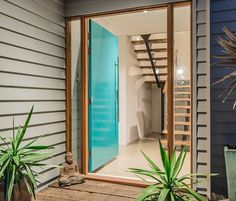 Beautiful homes are brought to live with beautiful doorways. This is the work of @bluewater_building and features Scyon Linea. #australianarchitecture #architecture #exteriordesign #doorways #scyonwalls