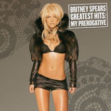 """Image of a blond woman dressed in a black ensemble in front of a gray background. """"Britney Spears Greatest Hits: My Prerogative"""" is written in white capital letters inside a white box."""