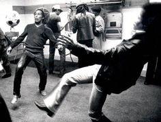 Jimi Hendrix and Bob Marley kicking around a soccer ball