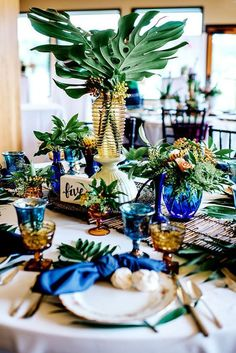 Tropical Wedding Table Decorations / http://www.himisspuff.com/green-tropical-leaves-wedding-ideas/9/