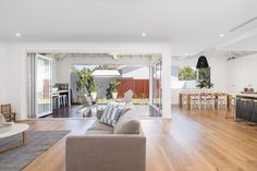 Contemporary Beach house Sydney | beach house | coastal architecture | contemporary home | Hampton style | modern Hamptons style | beach Kitchen | timber floors | weatherboard home | panelled ceiling | Hampton architecture |