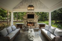 Z Plus Architects - decks/patios - covered patio, carriage lantern, outdoor fireplace, stone fireplace, outdoor stone fireplace, firewood ca...