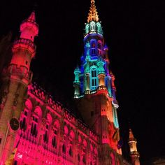 La Grand Place and Brussels City Hall tower, one of the UNESCO heritage monuments at night. Is a magical place in the heart of Europe