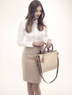 An effortless work wear look with a white blouse and a pencil skirt.