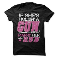 If Shes Holdin A Gun Marry Her or Run Cowgirl T-Shirt. Click to order your shirt here!