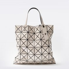 The Issey Miyake Bao Bao Lucent Basic Beige Polyvinyl Chloride Polyester  Nylon Polyurethane Brass Tote is a top 10 member favorite on Tradesy. 5838f6b8db1a7